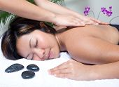 stock photo of massage therapy  - Woman having back massage therapy in spa - JPG