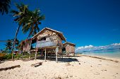 stock photo of shacks  - Wooden shack by a beach on a tropical island - JPG