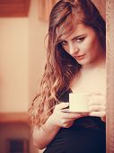 Woman Drinking Hot Coffee Beverage At Home poster