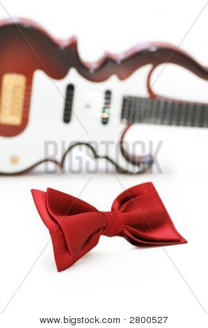Bow Tie And Guitar Isolated On White