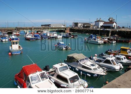 Small boats moored in Folkestone harbour in Kent, England.