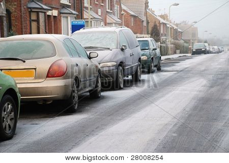 Cars and road covered in white on a frosty morning in Ashford, Kent, England.