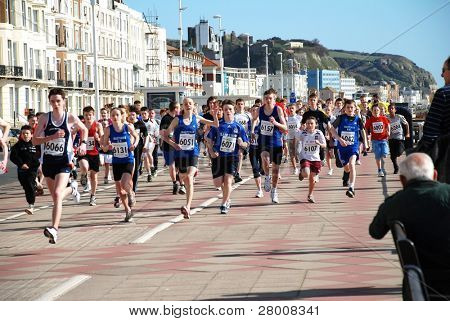 HASTINGS, ENGLAND-MARCH 15: Children take part in the 19th Hastings Mini Run on March 15, 2009 in Hastings, Sussex. The 2.5 k race is open to 11-16 year olds and takes place along the seafront.