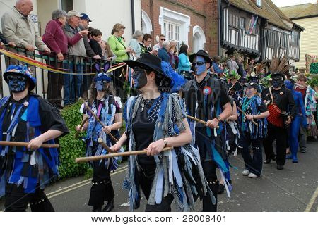HASTINGS, ENGLAND - MAY 5: Morris dancers parade through the Old Town area during the May Day, Jack In The Green festival on May 5, 2009 in Hastings, East Sussex.