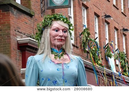 HASTINGS, ENGLAND - MAY 5: A large effigy of a woman (known as a Giant) is paraded through the Old Town during the annual Jack In The Green festival on May 5, 2009 in Hastings, East Sussex.