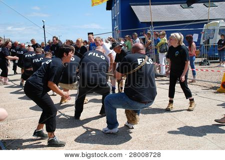 HASTINGS, ENGLAND - JULY 30: Local pub teams compete in a Tug of War match during the Old Town Carnival on July 30, 2011 in Hastings, East Sussex, England. Until 1920 the sport was part of the Olympic Games.