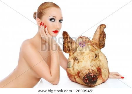 Conceptual image of young beautiful sexy woman with dead pig's head, over white background