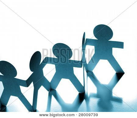 Group of paper chain people holding hands
