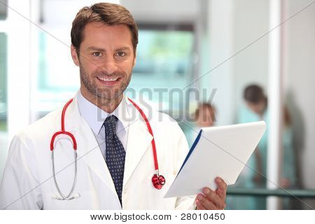 Hospital doctor checking patient notes