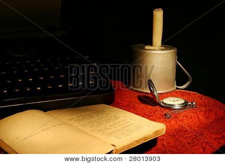 old book, ancient watch and candle