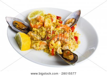 paella with oyster on the white plate