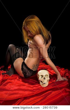 Girl with skull on red isolated background