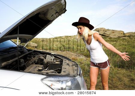 young beauty woman with broken car on the road