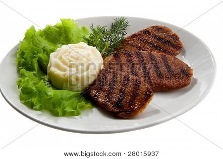 grilled meat with potato and leaf lettuce