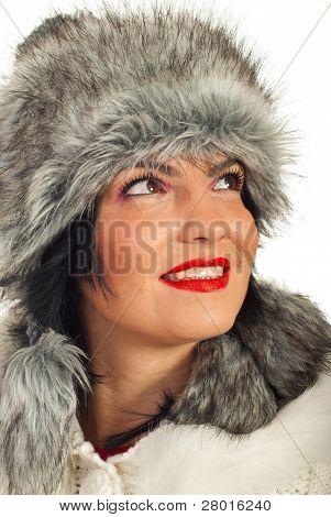 Elegant Woman In Fur Hat Looking Up