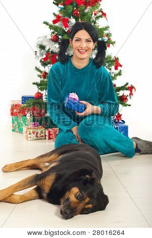 Laughing Woman In Pajamas Hold Xmas Gift
