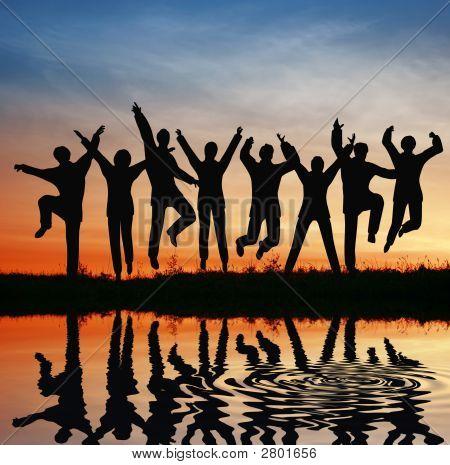 Silhouette Jump Team. Sunset Pond