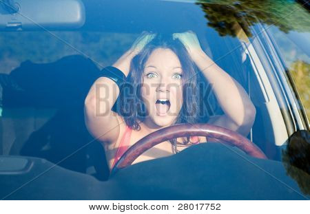 afraid girl into the car looking forward