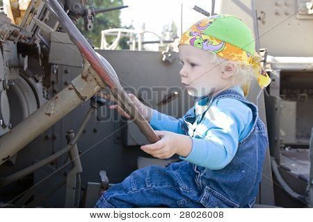 Baby Girl Driving An Armor Vehicle