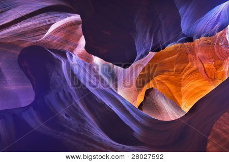 """Shone orange and violet colors a canyon of """"Antelope"""" in the USA in a bright sunny day"""