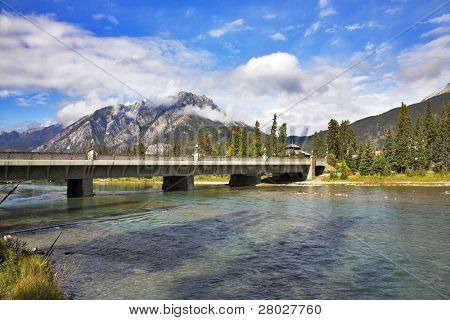 The bridge through the river and road to northern Canadian reserve Banff