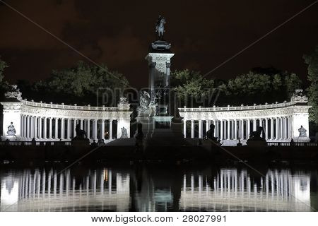 Silver fires of celebratory illumination of a colonnade in the Madrid park