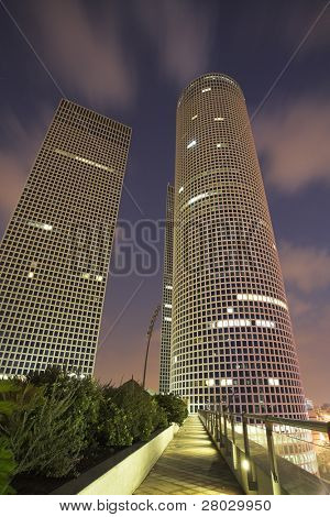 Round, square and triangular skyscrapers in business part Tel-Aviv on a sunset