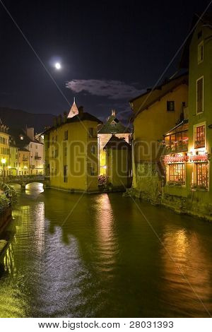 Evening time embankment of Annecy lake, lit by the moon