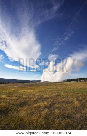 The most well-known of the world geyser in Yellowstone national park - Old Faithful. The beginning of eruption