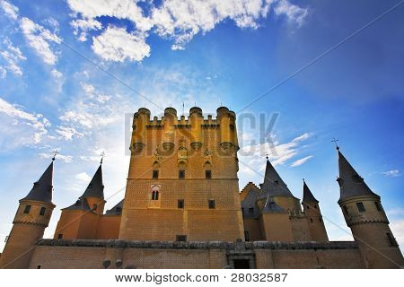 Medieval Spanish palace on a background of a spring  sunset