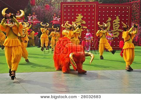 SHENZHEN - JANUARY 22: Chinese New Year Parade. Performance of dancing ensemble in picturesque suits on celebrating of the Chinese New year, JANUARY 22 in Shenzhen, China.