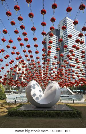 Traditional red lanterns and the modern abstract sculpture, decorating the Chinese city in New year