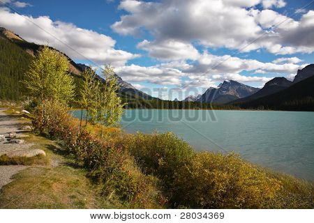 Footpath on coast of charming lake in Canada