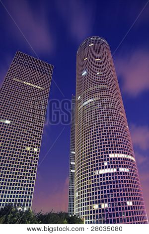 Magnificent high-altitude buildings in business part Tel-Aviv on a background of pink clouds