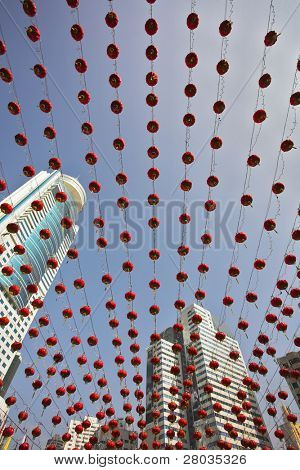 Traditional red lanterns and the modern skyscrapers decorating the Chinese city in New year