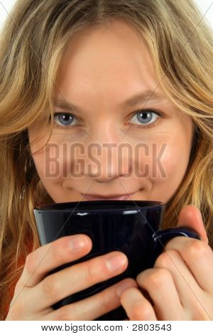 Charming Young Woman Drinking Tea