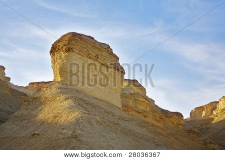 Hills of freakish forms from sandstone on a sunset