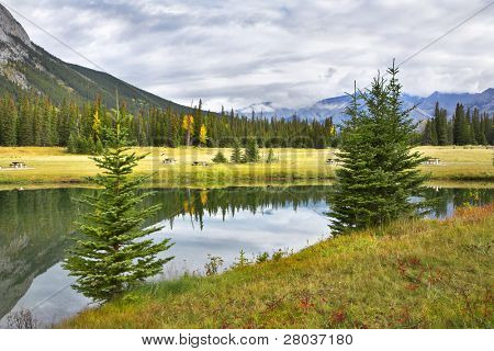 Small lake in the early cold morning in mountains of Canada. More magnificent pictures from the American and Canadian National parks you can look hundreds in my portfolio. Welcome!