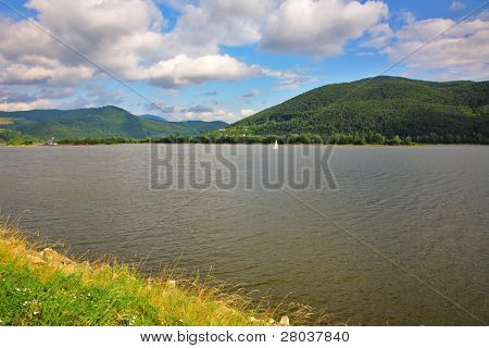 Sailing boat on quiet silent lake in Slovakia