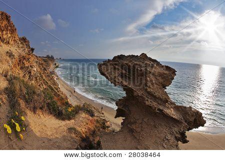 Freakish rocks on coast of Mediterranean sea shined by the sun