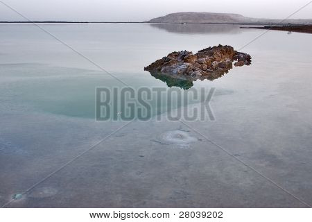 A stone in the shoaled salty Dead Sea