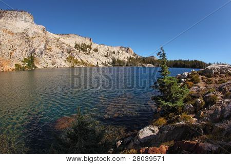 Early clear autumn morning. Picturesque transparent lake in mountains of national park Yosemite