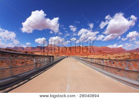 The bridge over the Colorado River and shining light clouds