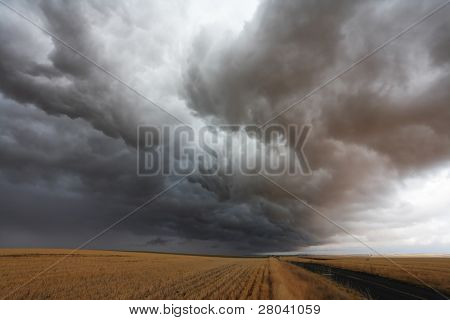 Terrible swirling storm cloud over rural roads