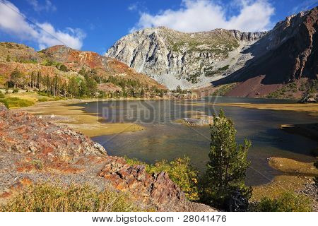 Picturesque superficial lake on pass Tioga in Yosemite park in the USA. Autumn midday
