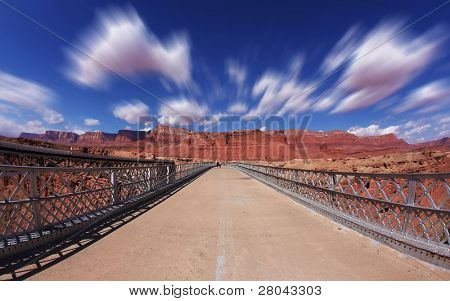 Clouds fly in the autumn wind on the bridge over the Colorado River