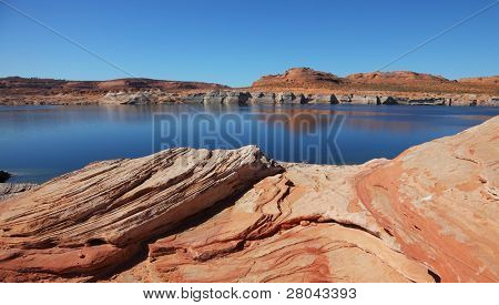 Antelope Canyon with a smooth blue water in the Navajo Reservation. Midday summer silence