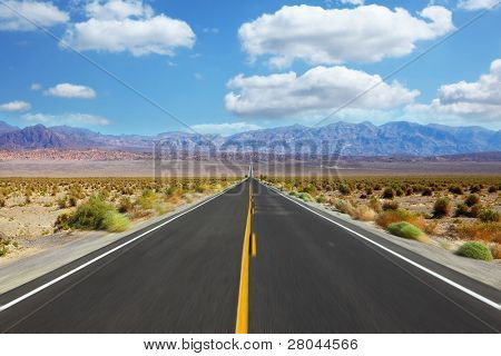 Great American road, crossing a huge Death Valley in California. A trip to the high speed