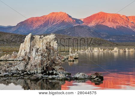 Sunrise on lake Mono in a crater of an ancient extinct volcano. Lake shallow, in it set of picturesque reeves of the Tufa