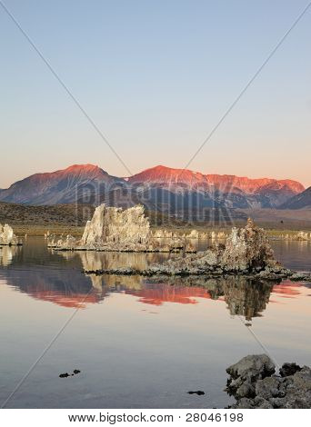 Shallow lake, a multitude of picturesque reefs Tufa. Magically beautiful sunrise. Sunrise at Mono Lake in the crater of an ancient extinct volcano.